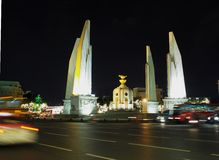 Democracy monument middle of RATCHA DAMNOEN road. Near the THAI grand palace in BANGKOK. night scene shot with motion blur , shallow depth of field, October 8 royalty free stock image