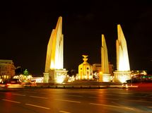 Democracy monument middle of RATCHA DAMNOEN road. Near the THAI grand palace in BANGKOK. night scene shot with motion blur , shallow depth of field, October 8 stock image