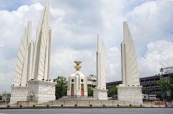 Democracy Monument is a public monument in the centre of Bangkok, capital of Thailand. And thai people driving vehicle on traffic road on May 11, 2017 in stock photography