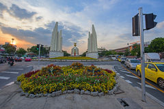 Democracy Monument at sunset. BANGKOK, THAILAND - DECEMBER 19, 2015: Democracy Monument at sunset. Here is the historic site of many of Thailand's street stock photo
