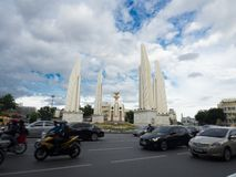 The Democracy Monument with the traffic, It occupies a traffic circle on the wide east-west Ratchadamnoen Avenue. BANGKOK, THAILAND. – On September 04 stock photos