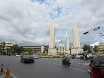 The Democracy Monument with the traffic, It occupies a traffic circle on the wide east-west Ratchadamnoen Avenue. BANGKOK, THAILAND. – On September 04 stock photo