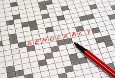 Democracy. Text in crossword. Red letters. Close-up royalty free stock photos