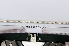Democracy conceptual. Democracy typed on vintage typewriter stock photography