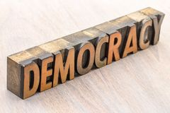 Democracy word abstract in wood type. Democracy word abstract in vintage letterpress wood type royalty free stock photo