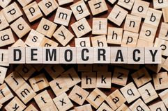 Democracy word concept. On cubes stock image