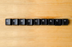 Democracy word. With keyboard buttons royalty free stock photography