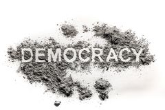 Democracy word text written in dirt, ash, sand stock photos