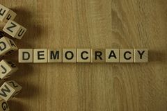 Democracy word from wooden blocks. On desk royalty free stock photography