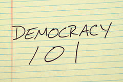 Democracy 101 On A Yellow Legal Pad. The words `Democracy 101` on a yellow legal pad stock photo