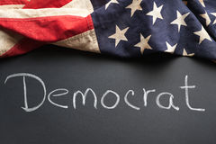 Democrat sign. A democrat sign written on a chalkboard with vintage American flag Stock Photos