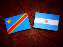 Democratic Republic of the Congo flag with Argentinian flag on a. Tree stump Stock Photos