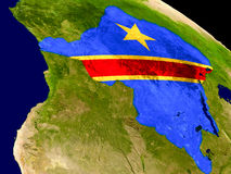 Democratic Republic of Congo with flag on Earth Stock Images