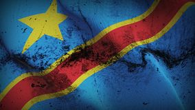 Democratic Republic of the Congo grunge dirty flag waving on wind. Democratic Republic of the Congo background fullscreen grease flag blowing on wind. Realistic Royalty Free Stock Image