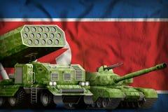 Demokratiska Folkrepubliken Korea Nordkorea tungt militärt pansarbilbegrepp på nationsflaggabakgrunden 3d dåligt Royaltyfria Bilder