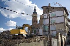 Demolish bulding. With an excavator at calatayud saragossa aragon spain stock photography