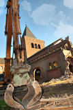 Demolish church. Demolition of a church with caterpillar by a lack of parishioners.Holy Heart church august 2012 Etten-leur Netherlands.fading catholicism Royalty Free Stock Photo