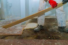 Demolish of old wooden parquet floor with home renovation. Demolish of old wooden parquet floor with house improvement renovation removal repairman replace royalty free stock image