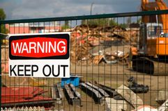 Demolished building. With a keep put sign on the fence Royalty Free Stock Image
