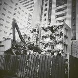 Demolished. Building in center of erected buildings Stock Photography