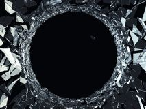 Demolished glass with sharp pieces and bullet hole. On black Stock Photography