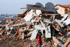 Demolished house. Little girl near demolished building Royalty Free Stock Image