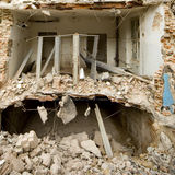 Demolished house and rubble Royalty Free Stock Images