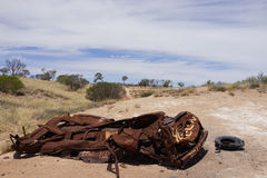 Demolished rust car in Australian desert Royalty Free Stock Image