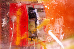 Demolished and vandalized public phone booth on street Stock Images