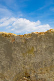 Demolished Wall. A demolished wall against a blue sky Royalty Free Stock Images