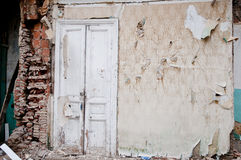 Demolished Wall ,Old wooden white door in capital tbilisi Stock Photography
