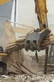 Demolishing. Heavy equipment working at demolition site Stock Photos