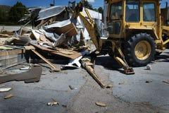 Demolishing Building Backhoe and Heavy Equipment Royalty Free Stock Image