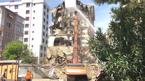 Demolishing a building for urban renewal in Istanbul. Revitalization program of land redevelopmen stock video footage