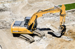 Demolishing. Demolition with digger at construction site Royalty Free Stock Image