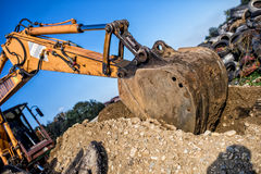 Demolishing operations at industrial construction site. worker using bulldozer wrecking Royalty Free Stock Photography