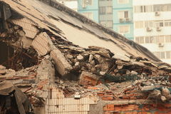 Demolition. A close view of part of destroyed building in demolition Stock Photos