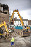 Demolition. Squad destroy an old building to start a new development Stock Photo