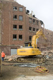 Demolition. Squad destroy an old building to start a new development Royalty Free Stock Image