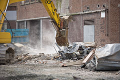 Demolition. Squad destroy an old building to start a new development Stock Image