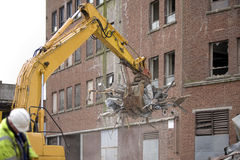 Demolition. Squad destroy an old building to start a new development Stock Images