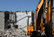 Demolition. Dredge doing demolition of building in the city center Stock Photos