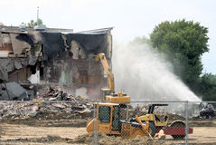 Demolition 2. Old school demolition site with machines and water mister Stock Photo