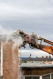 Demolition!. A machine bites into a wall stock images
