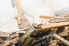 Demolition. Industry machine taking down walls of old factory building Royalty Free Stock Photos