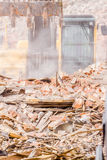 Demolition. Industry machine taking down walls of old factory building Royalty Free Stock Photography