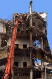 Demolition. In Warsaw center. Heavy machine is crushing old shopping mall Royalty Free Stock Images