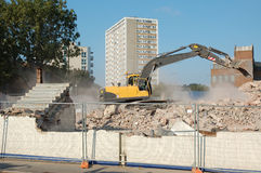 Demolition. Site. Large digger collects the rubble Stock Photo