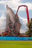 Demolition of the building. By a large machine building Stock Photography