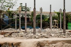 Demolition of a building with concrete floors and pillars, old house.  Royalty Free Stock Image